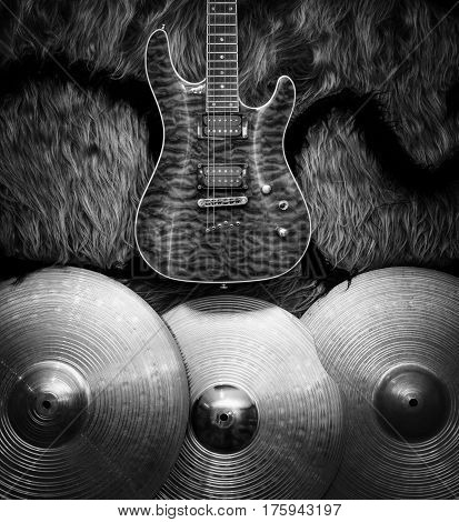 Electric guitar with three cymbals on faux fur wall. Musical instruments blck and white background