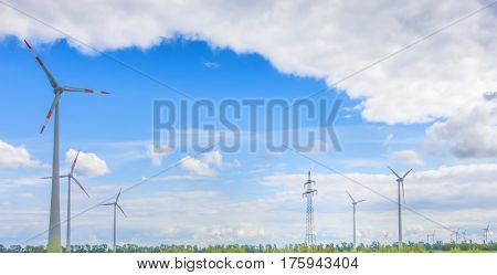 wind generator turbines on a sunny day