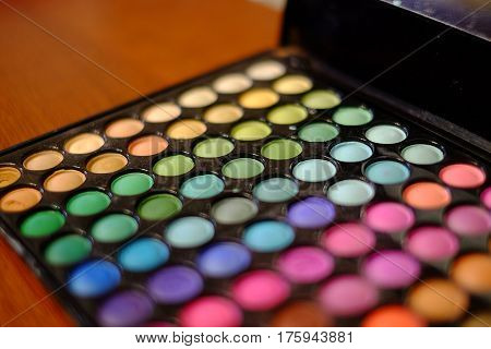 Pallete of vary colors shadows and blush