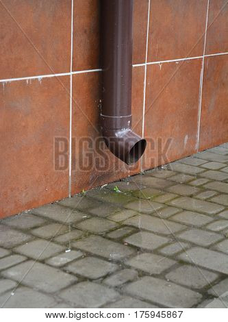 Rain Gutter Plastic Pipeline without Drainage Downspout SystemPavement near House Foundation