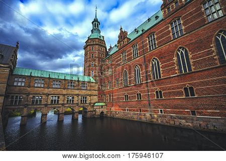 Frederiksborg castle in Hillerod Denmark which was a royal residence for King Christian IV and is now known as The Museum of National History. It is the largest Renaissance palace in Scandinavia