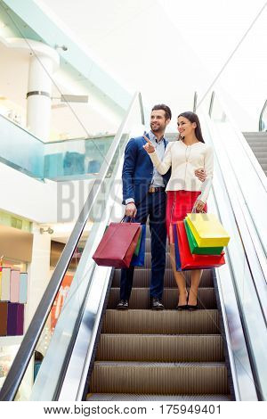 Consumerism, Sale And People Concept - Stylish Beautiful Happy Young Couple In Love With Shopping Ba