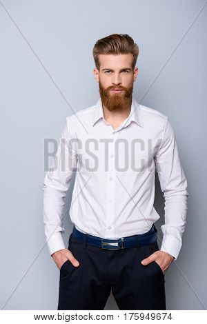 Portrait Of Serious Confident  Bearded Man In Formalwear Holding Hands In Pockets