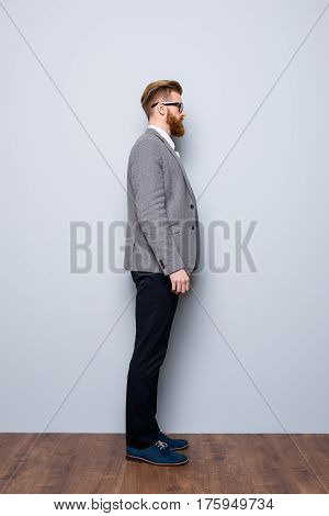 Full-length Side View Portrait Of Serious Smart  Confident  Bearded Man In Formalwear And Spectacles