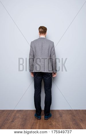 Full-length Back View Portrait Of Smart  Confident  Bearded Man In Formalwear