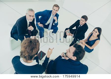 Top View Of Confident Co-workers Discussing  New Business Plan At Meeting