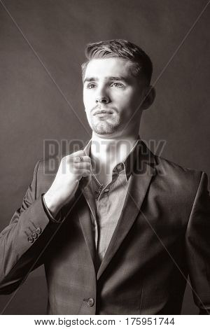 Stylish young brunet in suit