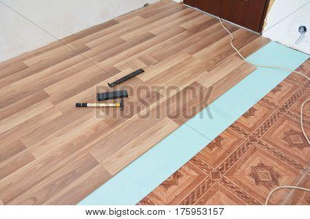 Installing laminate flooring. Laminate flooring installation interior.