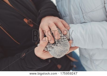 Hands together. Close-up of loving couple holding hands while walking outdoors