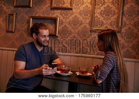 Chatting Young Couple In A Pub