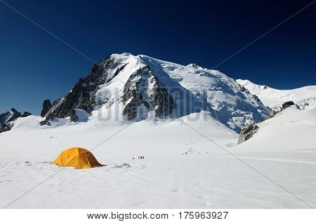 yellow touristic tent before ice wall in Mont Blanc