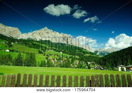 Green meadow in alpine village Dolomites, Alps, Italy