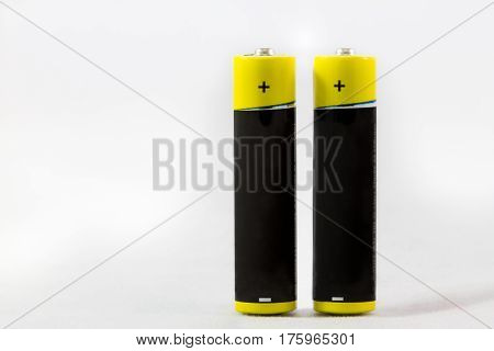 Two Standing Yellow-black Aaa Alkaline Batteries Isolated On White
