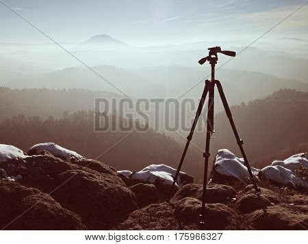 Tripod On Peak Ready For Photography. Sharp Autumn Mountains
