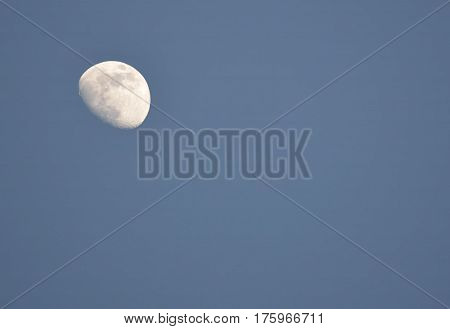Three quarter moon in the evening sky