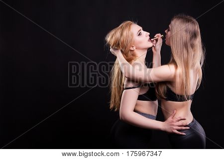 Sexy Girl Applying Lipstick To Other Hot Girl