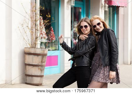 Two Girl Friends Having Fun Outside In The City