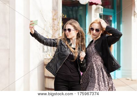 Two Young Female Friends Taking A Selfie Outdoor