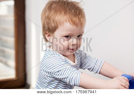 Smiling Child Boy At His Home