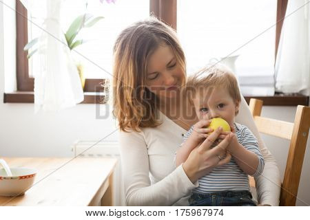 Mother And Child Playing At The Kitchen