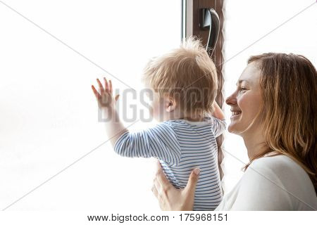 Mother And Child Playing At The Window