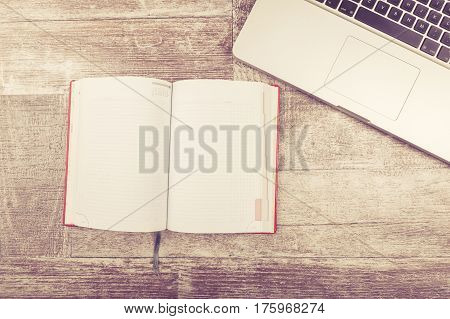 Laptop And A Notebook For Writing In Vintage Tone