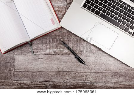 Open Writing Notebook Next To A Laptop