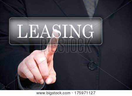 Leasing - female hand with touchscreen button