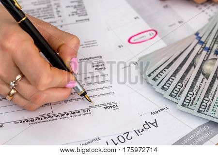 Woman Filing Us Tax Form. Annual Budget.