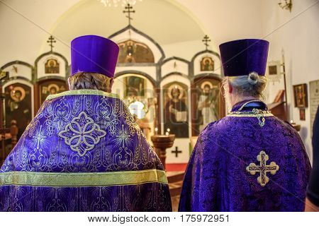 RIO DE JANEIRO, BRAZIL - MARCH 05, 2017: Backs of two priests celebrating the Feast of Orthodoxy at the Russian Orthodox Church of the Holy Martyr Zenaide in Rio de Janeiro, Brazil