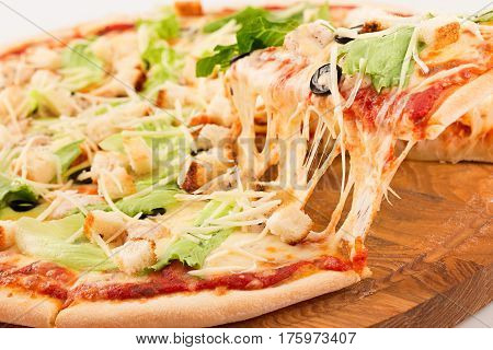 Caesar Pizza, mozzarella cheese, Caesar sauce, iceberg lettuce, parmesan, croutons, chicken, black olives, cherry tomatoes isolated on white background