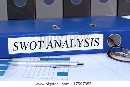 SWOT Analysis - blue binder on desk in the office
