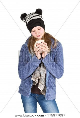 Young girl with jacket and wooly hat holding cup isolated on white background