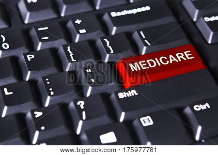 Closeup of computer keyboard with Medicare word on the red button