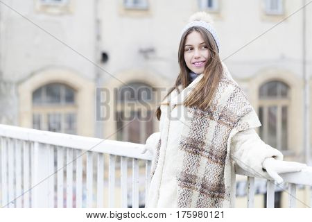 Beautiful Young Woman On The Bridge