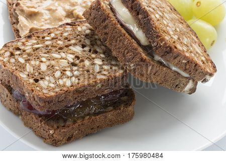 Two sandwiches made with square wholegrain bread
