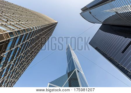 Contemporary skyscrapers on the blue sky background in Singapore. View from below. Horizontal.