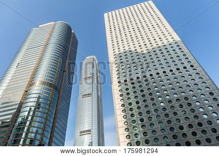 Three skyscrapers on the blue sky background in Singapore. View from below. Horizontal.