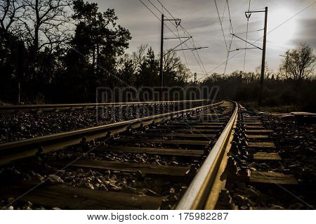 rail curved track with wooden sleepers electric lines and no train
