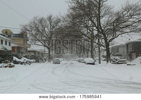 BROOKLYN, NEW YORK - FEBRUARY 9, 2017: Cars under snow in Brooklyn, NY after massive Winter Storm Niko strikes Northeast.