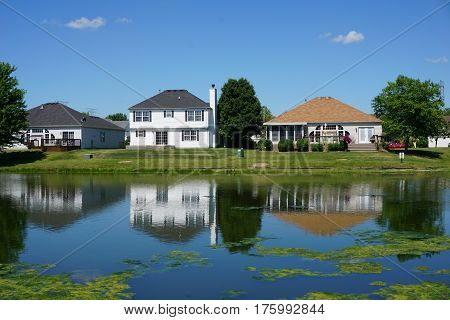 Lakefront homes in Joliet, Illinois during June.