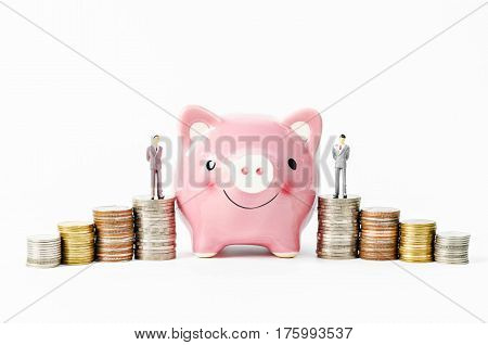 piggy savings with stack of coins money on white background. Savings for home concept.