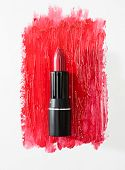 Smudged red lipstick isolated on white background. poster