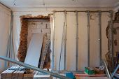 Interior of apartment with materials during on the renovation and construction ( remodel wall from gypsum plasterboard) poster
