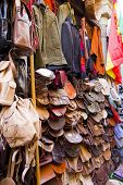 Shop with sale of handbags and leather work in the oriental market of the city of Granada. Andalusia Spain. poster