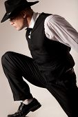 Attractive muscular male model wearing waistcoat and black hat poster