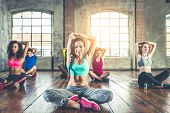 Group of sportive people training in a gym - Multi-ethnic group of athletes doing fitness poster