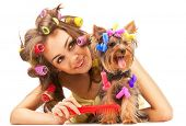 Shot of young adult female with Yorkshire Terrier dog poster