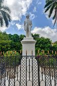 Statue to Carlos Manuel de Cespedes in Old Havana. Cespedes in considered the Father of the Cuban Nation. He freed the slaves and incited the insurrection against colonialism poster