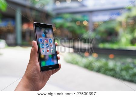 Chiang Mai, Thailand - May 05,2018: Man Holding Huawei With Icons Of Social Media On The Screen. Soc